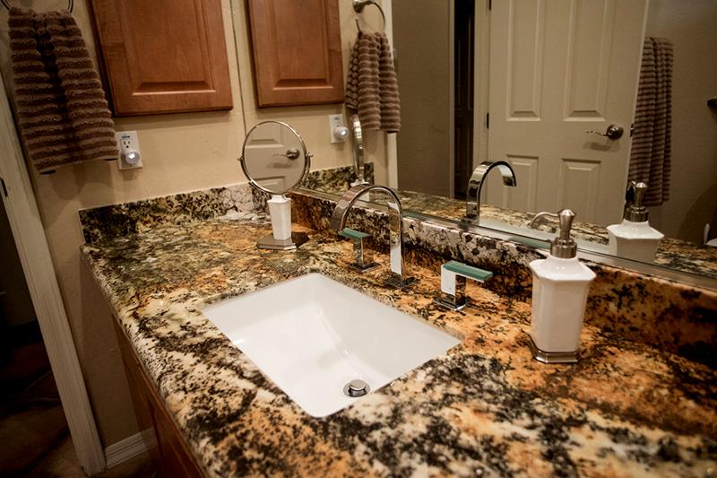 Bathroom countertop made with dark granite