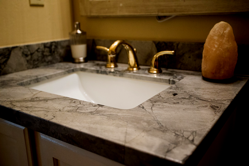 Square Granite Bathroom Sink Close up of Square bathroom washbasin and grey  and black granite counter top installed in Glendale home.