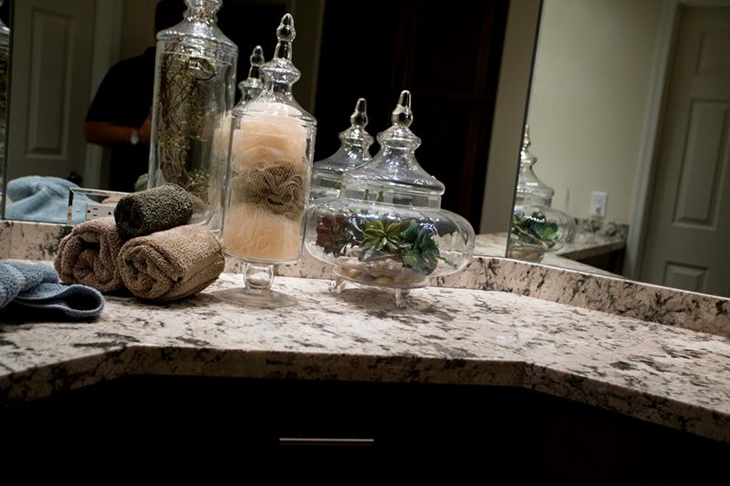 Close Up Of A Granite Bathroom Countertop Wrapped Around A Corner ...