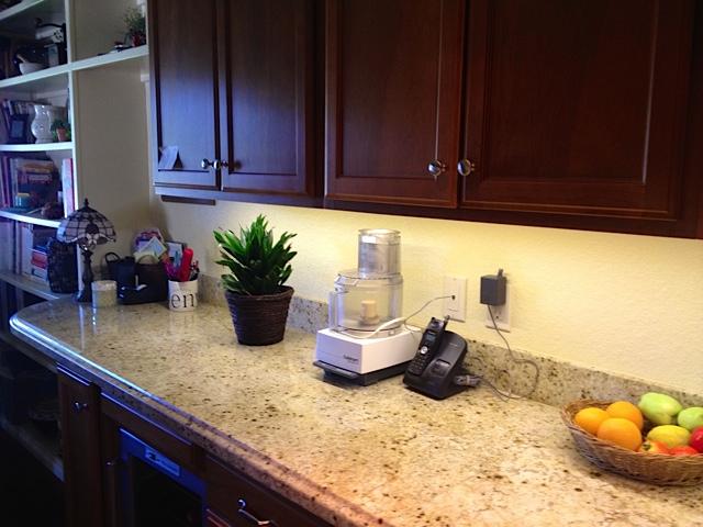 Granite counter top Kashmir White and dark brown cabinet