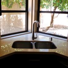 Granite counter top Honey Onyx Corner tap facing two windows