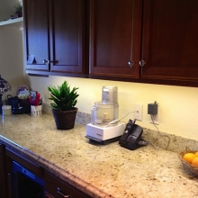 Granite counter top Kashmir White and dark brown cabinet
