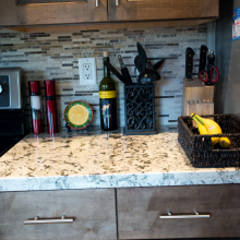 Arizona Granite finished installation of a black and white colored kitchen countertop